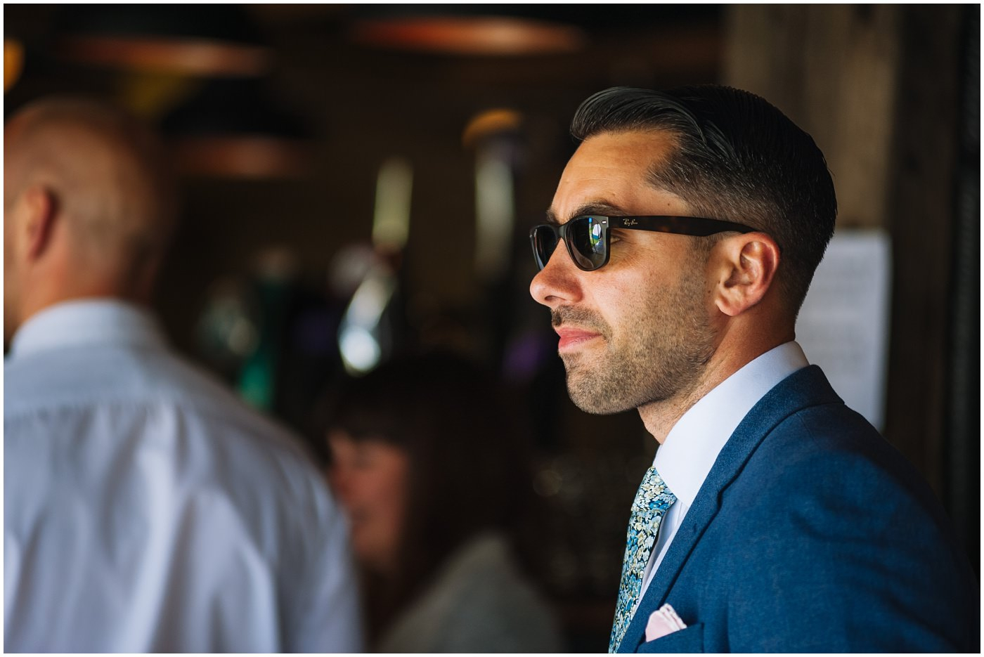 groom wearing sunglasses awaits his bride for festival wedding at wildwood and eden