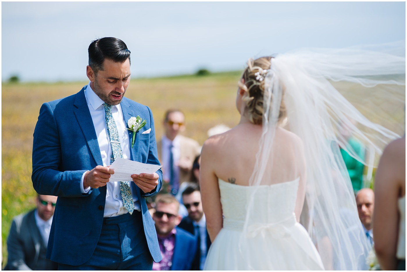 groom reads his vows in outdoor wedding ceremony at wildwood and eden