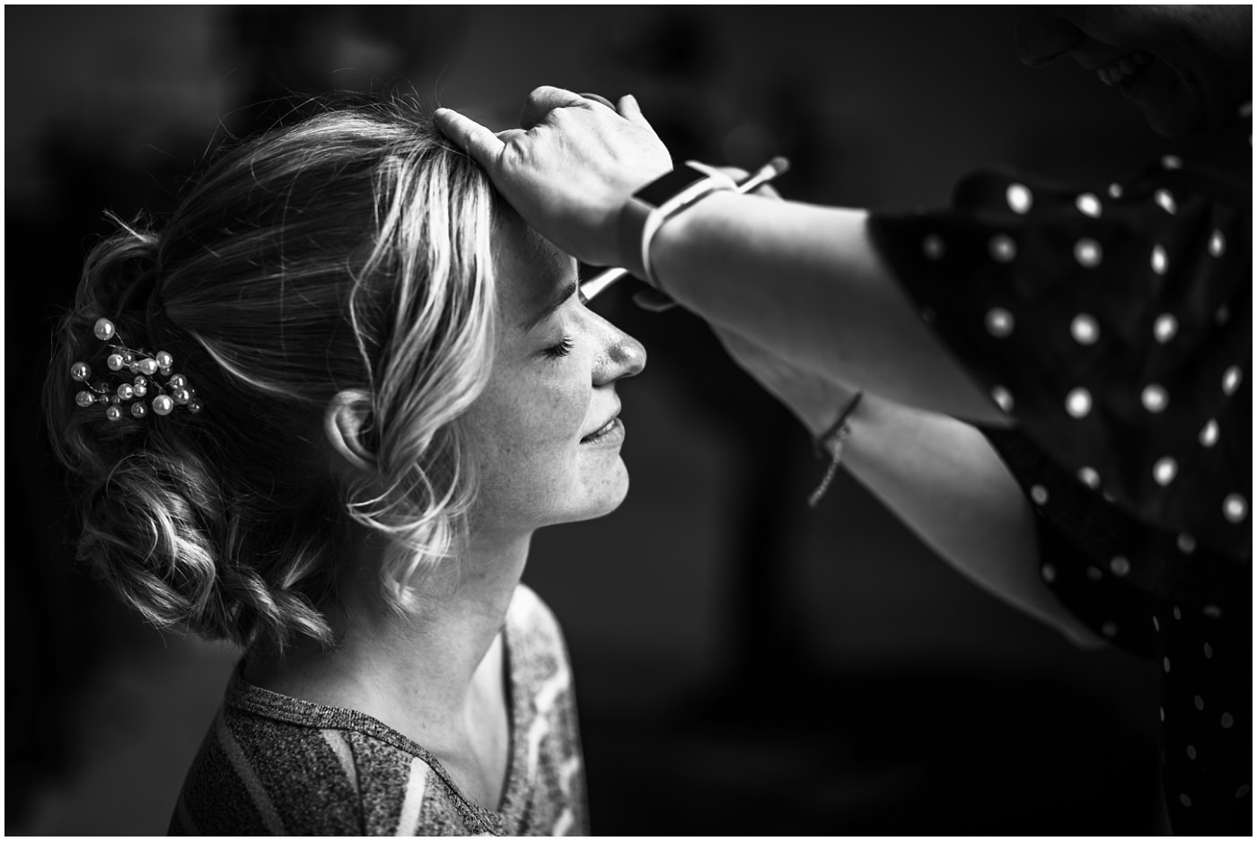 bridal prep photograph in black and white
