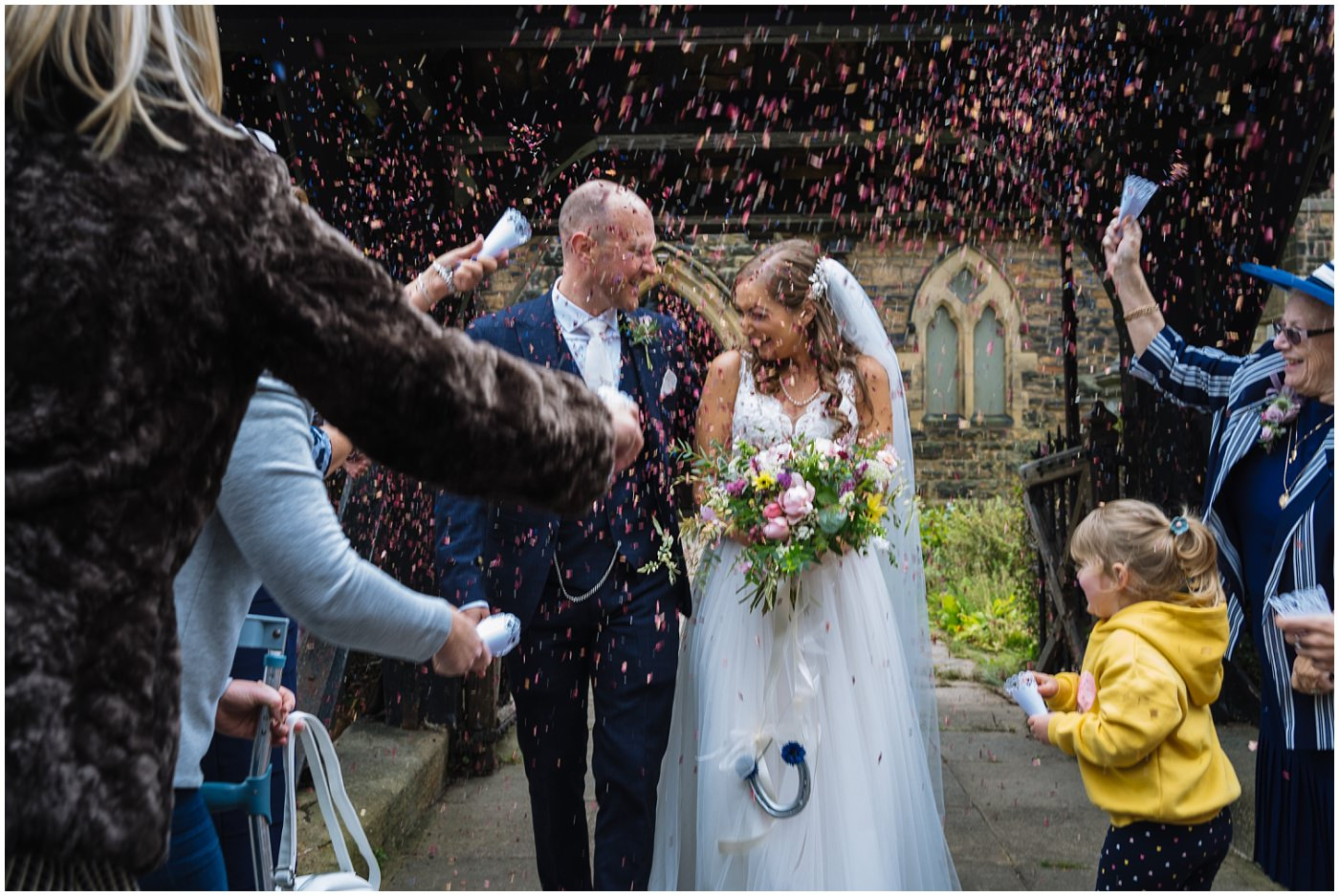 Confetti on bride and groom at Shireburn Arms Wedding